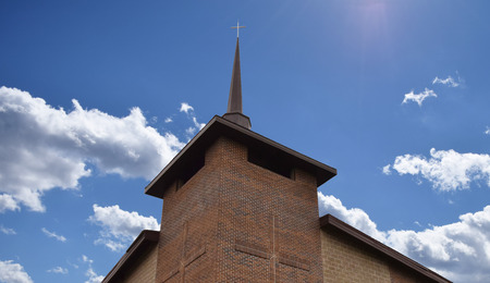 Large church steeple set against a beautiful sky. Stock Photo