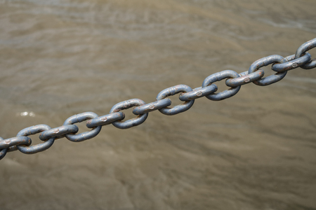 A strong chain used as a pedestrian guard rail along the Mississippi River Banco de Imagens