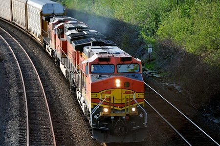 cargo service: The freight train moving along the coastline. Stock Photo