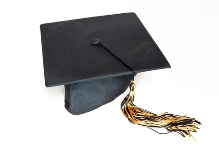 Black graduation cap with tassel on the white background. photo