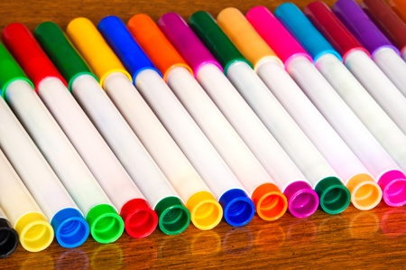 Back to school, set of color markers on the table.