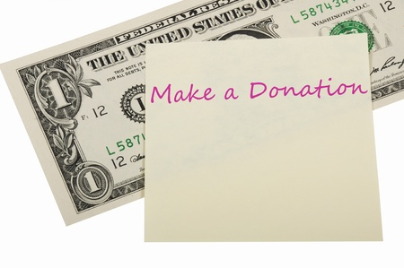 donations: Dollar and a sticker on the white background, concept of donation. Stock Photo