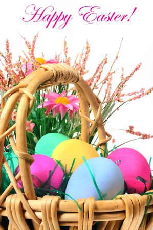 Easter colored eggs in the basket on the white background. Happy Easter!  photo