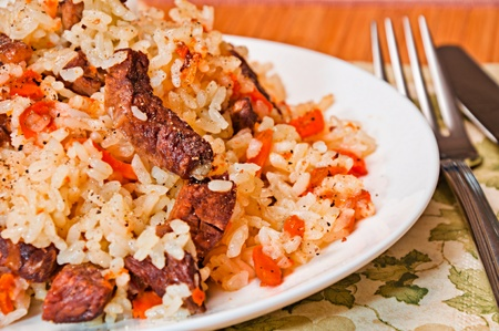 Pilaf made ​​of rice, carrot and meat.