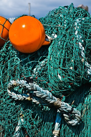 Close-up fishing net with a bright orange floats. photo
