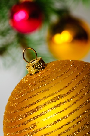 christmasy: Close up decorative ball on the background of Christmas tree.