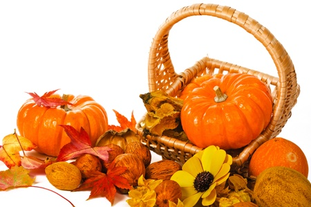 Close up composition of pumpkins, nuts and leaves on the table. photo