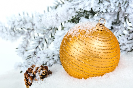 christmasy: Close up of decorative Christmas ball on the snow and Christmas tree as a background.