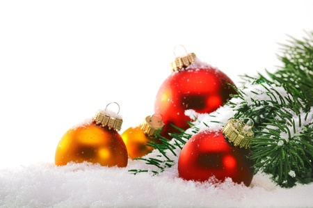 Decorative Christmas balls and Christmas tree on the snow. photo