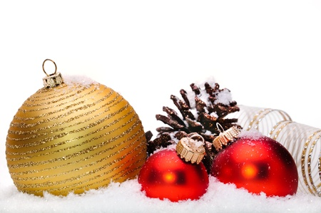 Close up of decorative Christmas ornaments on the snow. Stock Photo