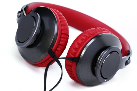 Fashion headphones made of red leather on a white background.