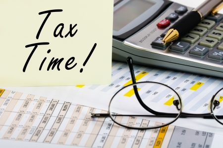 Tax forms with pen, calculator, glass and sticker. Stock Photo