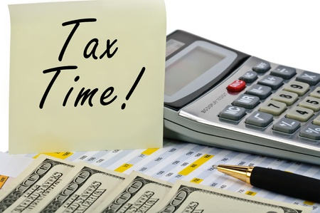 Tax forms with pen, calculator, money and sticker. Isolated. photo