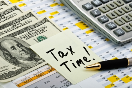 tax law: Financial forms with pen, calculator, money and sticker. Stock Photo