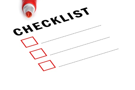 Checklist with red felt marker and checked boxes.  photo