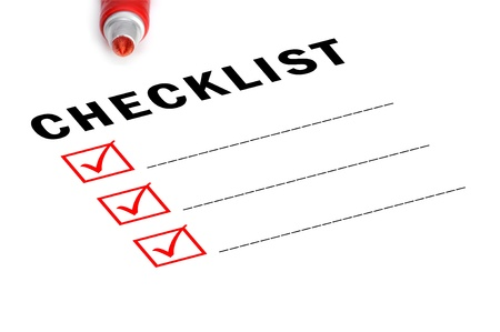 put tick: Checklist with red felt marker and checked boxes.  Stock Photo