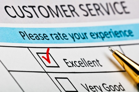 excellent: Customer service satisfaction survey form with red tick placed in excellent checkbox.
