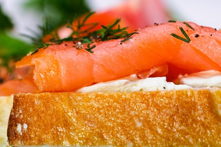 Sandwiches with smoked salmon, cream cheese and herbs. photo