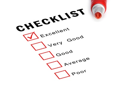 Checklist with red felt marker and checked boxes.  Stock Photo