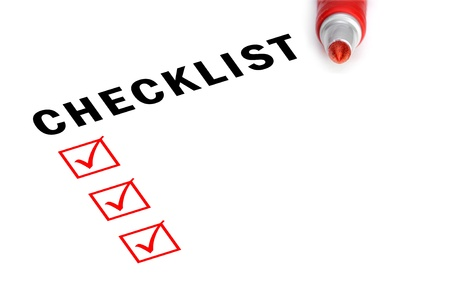 yes check mark: Checklist with red felt marker and checked boxes.  Stock Photo