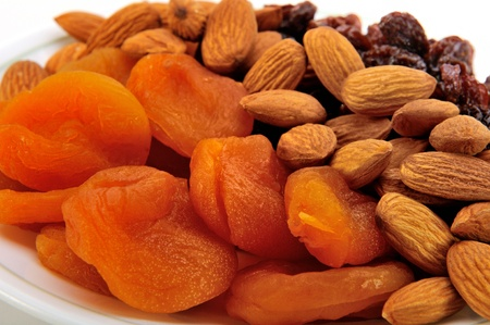 Delicious and healthy mixed dried fruit and nuts. photo