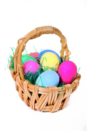 flower baskets: Easter colored eggs in the basket on the white background