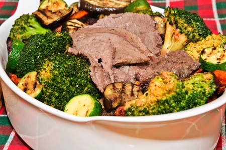 Beef with vegetables cooked in the oven. Stock Photo