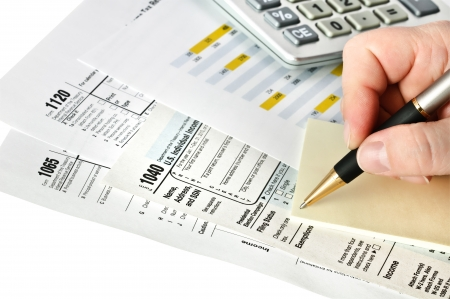 taxation: Tax forms with pen, calculator and sticker. Isolated. Stock Photo