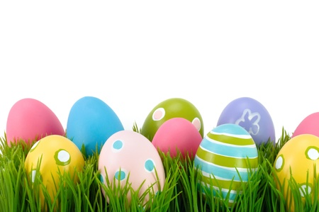 easter holiday: Easter colored eggs on the green grass   Stock Photo