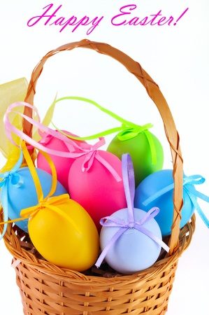 Easter colored eggs in the basket on the white background  Happy Easter