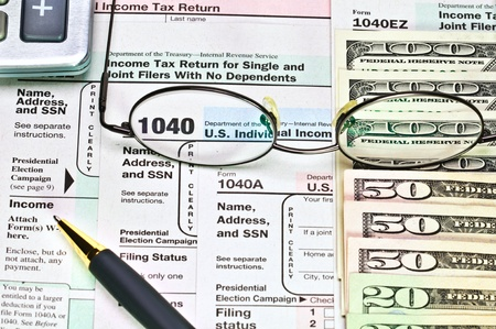 Tax forms 1040 with pen, calculator and money  Stock Photo