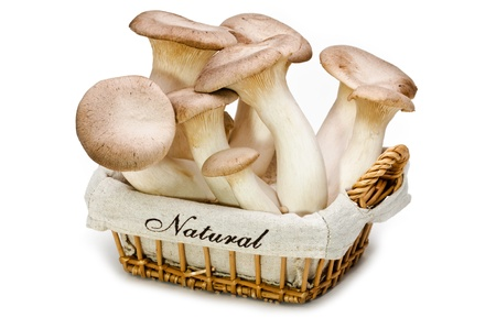 King trumpet  Fresh mushrooms in a basket on a white background  Stock Photo