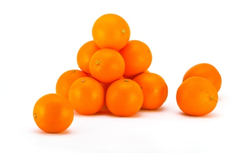 Bright fresh oranges on a white background