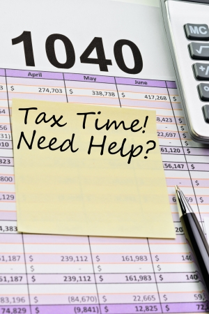 spread sheet: Tax forms 1040, spread sheet with pen, calculator and sticker.