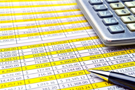 instruction sheet: Financial forms with pen and calculator.