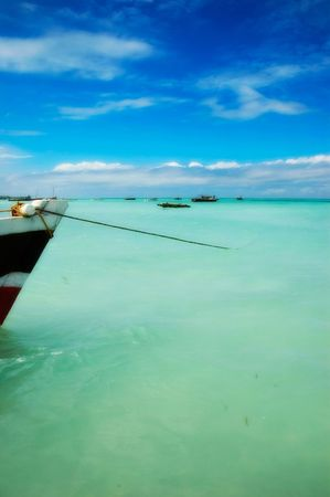 Anchored Boat in Tropical Water