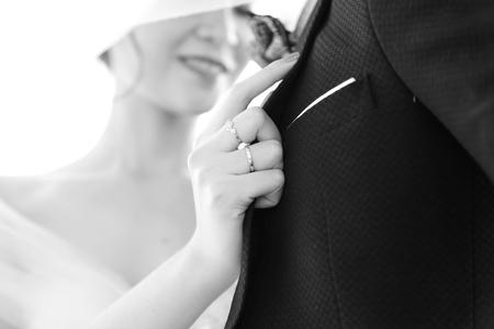 Wedding rings on hands. Imagens