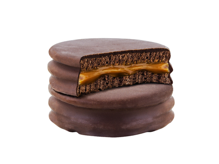 advice with bite chocolate alfajor biscuit cookie, caramel filled and white backgroun Stock Photo