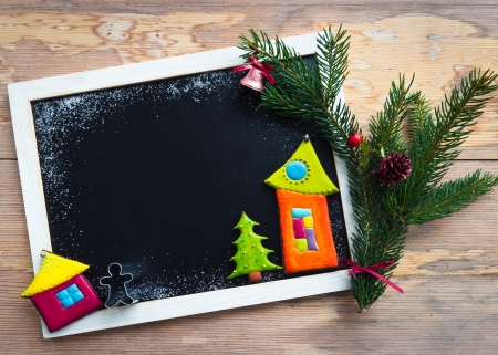 Blackboard decorated with colorful christmas  cookies and fir tree branch  photo