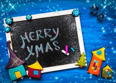 Blackboard decorated with colorful christmas cookies photo