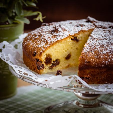 Homemade vanilla cake with raisins. Selective focus photo