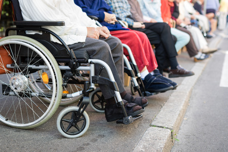 Row of old people in wheel chairs. Selective focus Standard-Bild