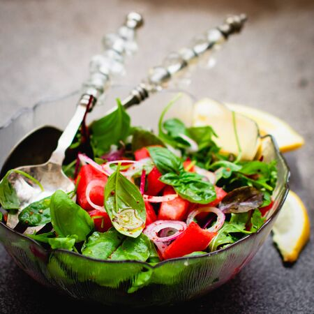 Vegan watermelon salad in a glass bowl
