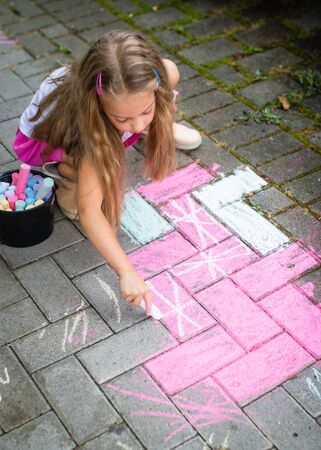 children drawing with colorful chalks