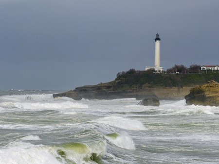 White lighthouse on a rock with stormy sea at Biarritz in France.