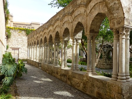Elegant cloister with pointed arches of the church of San Giovanni degli Eremiti in Palermo, Sicily, Italy