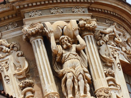 Detail of the dome of the Carmine Maggiore church in Palermo with the sculpture of a man who seems to raise it. Sicily Italy