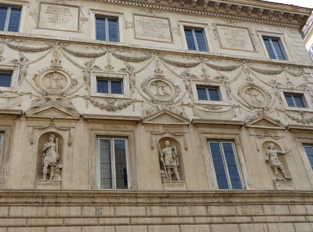 Ornate facade of statues at Palazzo Spada in Rome Italy,