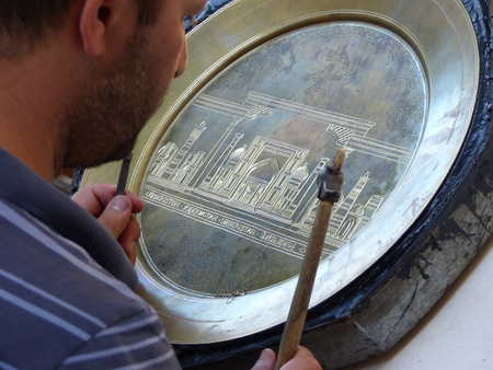 Decoration of a handmade copper plate from a craftsman in Uzbekistan.