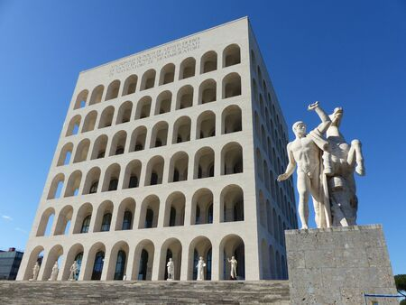 Palace of Roman civilization with the statues of men and horses in the Eur quaritere in Rome in Italy.